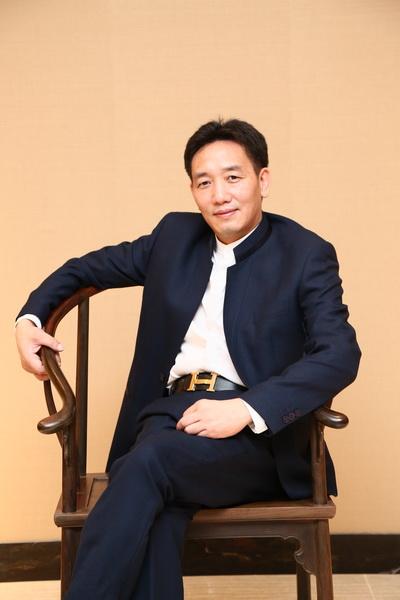 中山集古韵今(大不同)董事长 陈新平_调整大小.JPG